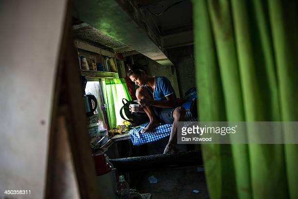 Dedenick Omoy 14 eats food in a cabin aboard a tanker in a particularly badly damaged part of Tacloban on November 18 2013 in Leyte Philippines...