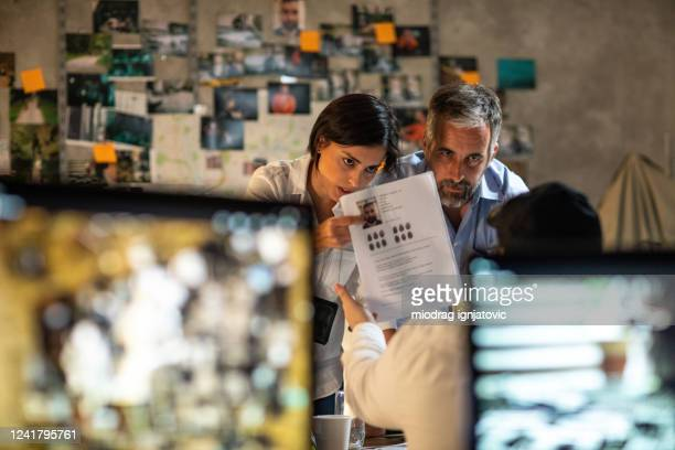 dedicated fbi team working together at office late at night to solve the case - privateinvestigator stock pictures, royalty-free photos & images