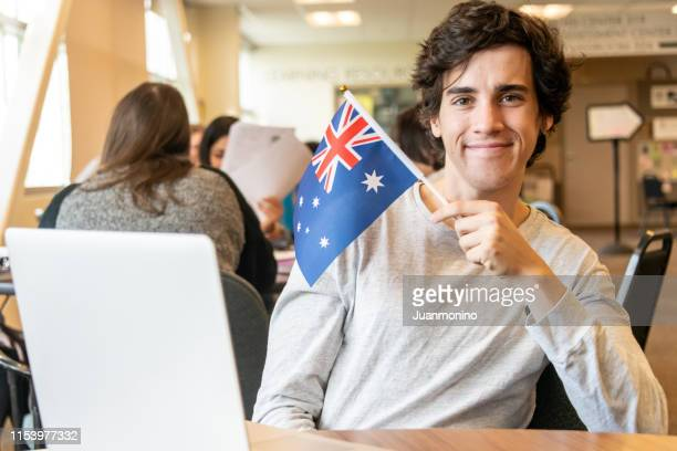 dedicated male college exchange student - australian flag stock pictures, royalty-free photos & images
