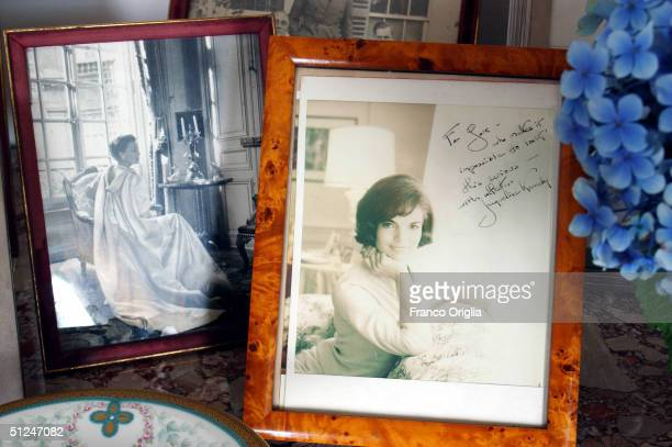 A dedicated portrait of Jaqueline Kennedy and a portrait of Greta Garbo are seen in the living room of Gore Vidal's 'Villa la Rondinaia' the Italian...
