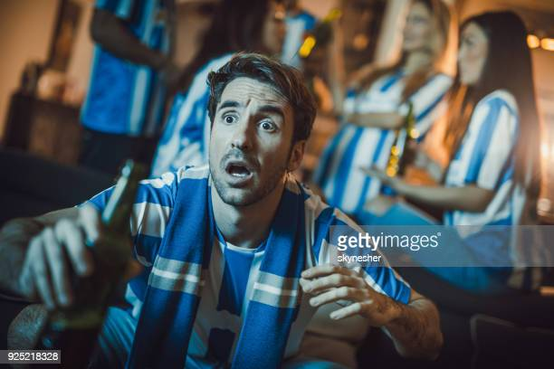 dedicated sports fan anticipating the victory of his soccer team at home. - mens world championship stock photos and pictures