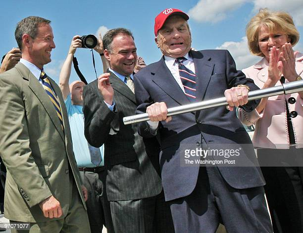 Dedication ceremony for the completion of he second span of the Woodrow Wilson Memorial bridge. Pictured, Sen. John Warner, in red cap, tightens the...