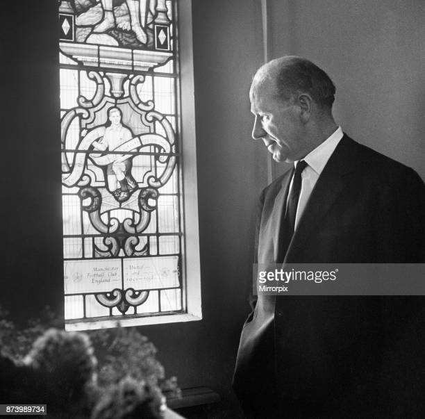 Dedication of the Duncan Edwards window in the church of St. Francis, in the priory, Dudley, West Midlands: pictured is Matt Busby examines the...