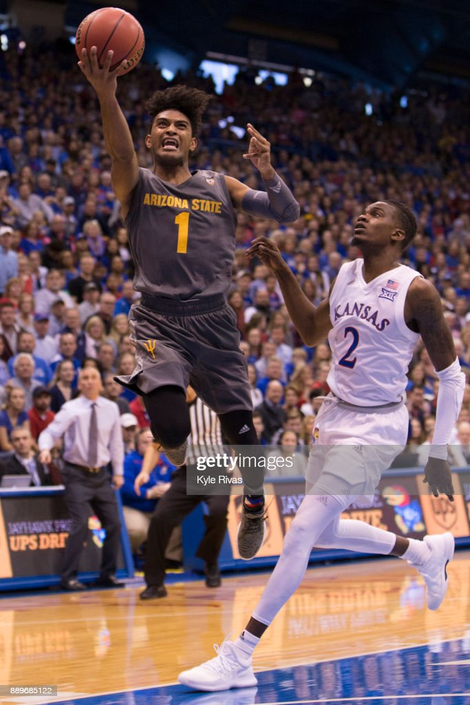Dedric Lawson #1 of the Kansas Jayhawks drives past Rob Edwards #2 of the Arizona State Sun Devils in the second half at Allen Fieldhouse on December 10, 2017 in Lawrence, Kansas.