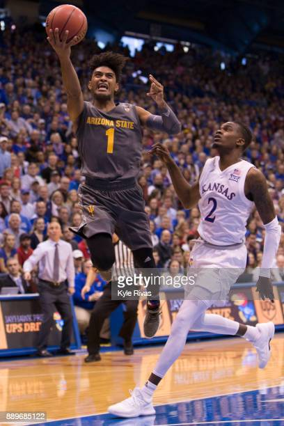 Dedric Lawson of the Kansas Jayhawks drives past Rob Edwards of the Arizona State Sun Devils in the second half at Allen Fieldhouse on December 10...