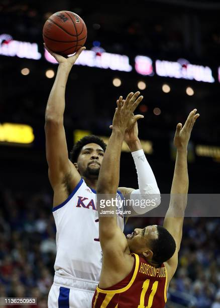 Dedric Lawson of the Kansas Jayhawks shoots over Talen HortonTucker of the Iowa State Cyclones during the Big 12 Basketball Tournament Finals at...
