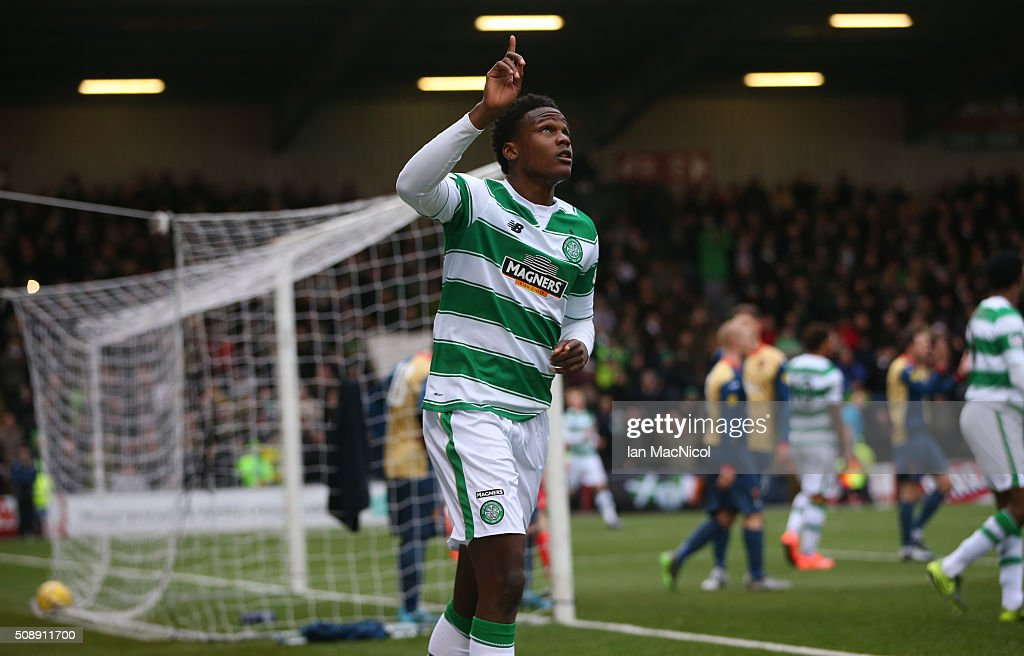 Dedryck Boyata celebrates after Leigh Griffiths of Celtic scores during the William Hill Scottish Cup Fifth Round match between East Kilbride and Celtic at Excelsior Stadium on February 7, 2016 in Airdrie, Scotland.