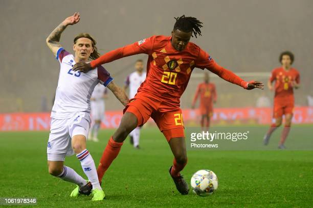 Dedryck Boyata defender of Belgium battles for the ball with Ari Skulason midfielder of Iceland during the UEFA Nations League Group Stage League A...