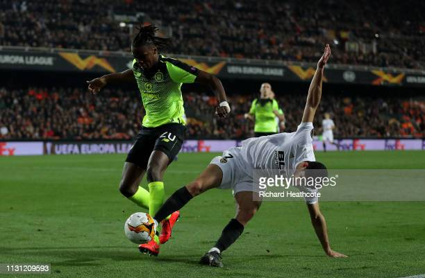 Dedryck Boyata of Celtic is challenged by Goncalo Guedes of Valencia during the UEFA Europa League Round of 32 Second Leg match between Valencia v...