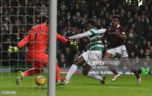 Dedryck Boyata of Celtic scores his team's second goal during the Scottish Premier League match between Celtic and Heart of Midlothian at Celtic Park...