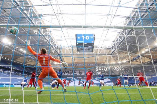 Dedryck Boyata of Hertha BSC scores their side's first goal past Ralf Faehrmann of FC Schalke 04 during the Bundesliga match between FC Schalke 04...