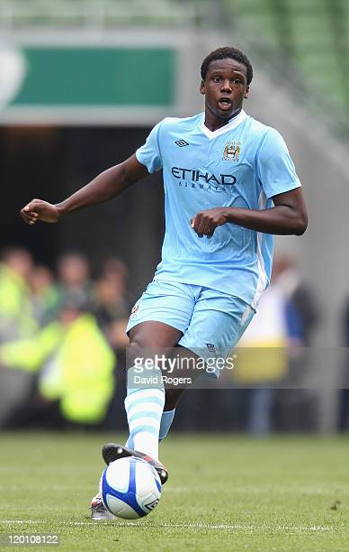 Dedryck Boyata of Manchester City passes the ball during the Dublin Super Cup match between Manchester City and Airtricity XI at Aviva Stadium on...