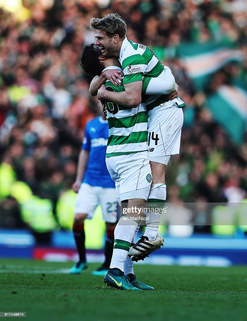 Dedyck Boyata celebrates with Stuart Armstrong of Celtic at full time during the Betfred Cup Semi Final match between Rangers and Celtic at Hampden Park on October 23, 2016 in Glasgow, Scotland.
