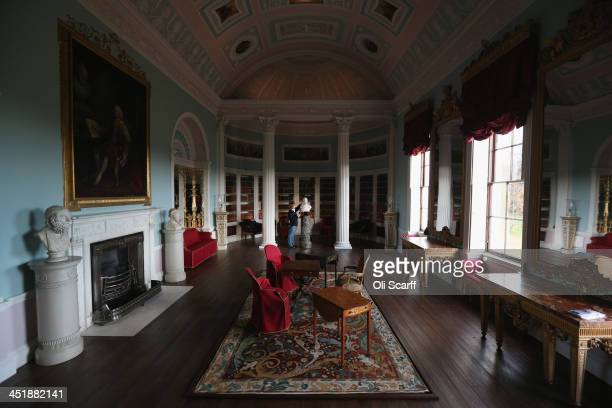 Dee Alston a member of the Conservation Team cleans a bust of Lord Mansfield in the Library of English Heritage's Kenwood House on the northern edge...
