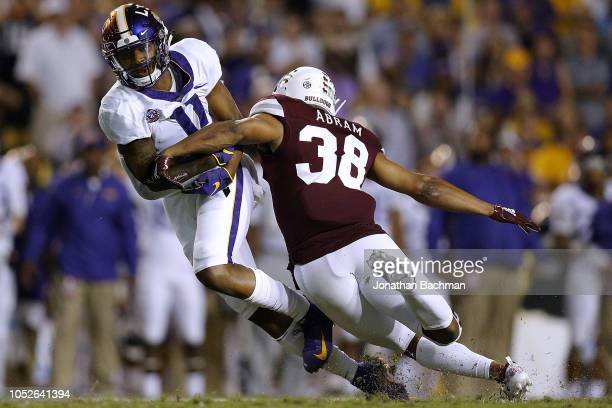 Dee Anderson of the LSU Tigers is tackled by Johnathan Abram of the Mississippi State Bulldogs during the first half at Tiger Stadium on October 20...
