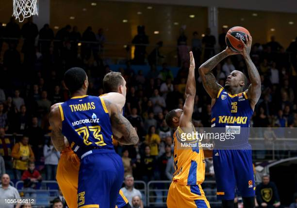 Dee Bost #3 of Khimki Moscow Region competes with Clevin Hannah #5 of Herbalife Gran Canaria in action during the 2018/2019 Turkish Airlines...