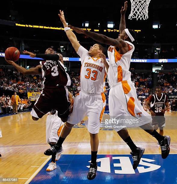 Dee Bost of the Mississippi State Bulldogs makes a shot over Brian Williams and Tyler Smith of the Tennessee Volunteers during the Championship game...