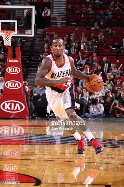 Dee Bost of the Portland Trail blazers dribbles the ball to the basket against the Los Angeles Clippers on October 7 2013 at the Moda Center Arena in...