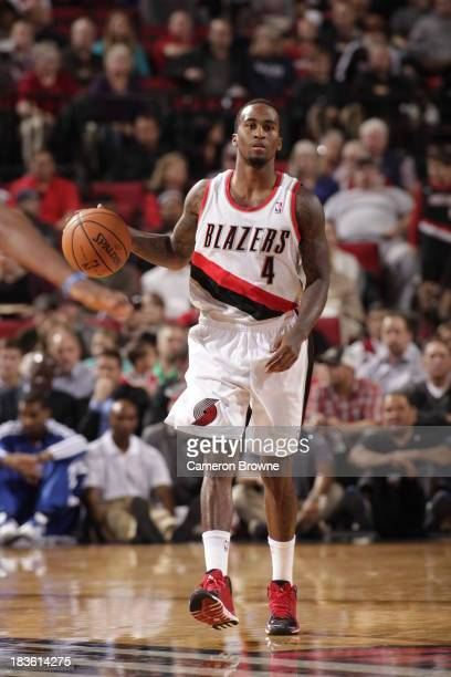 Dee Bost of the Portland Trail blazers dribbles the ball up the floor against the Los Angeles Clippers on October 7 2013 at the Moda Center Arena in...
