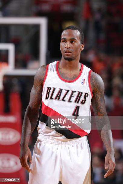 Dee Bost of the Portland Trail Blazers walks up court against the Los Angeles Clippers on October 7 2013 at the Moda Center Arena in Portland Oregon...