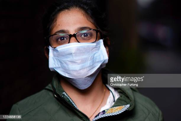 Dee Braich poses wearing her face mask as she goes about essential chores on May 13, 2020 in Darlaston, West Midlands, United Kingdom. People are...