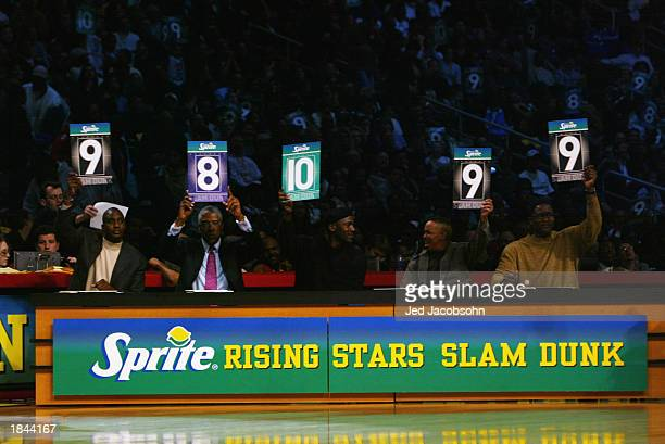 Dee Brown Julius Dr J Erving Michael Jordan Anthony Spud Webb and Dominique Wilkins judge the Sprite Rising Stars Slam Dunk Contest during the 2003...