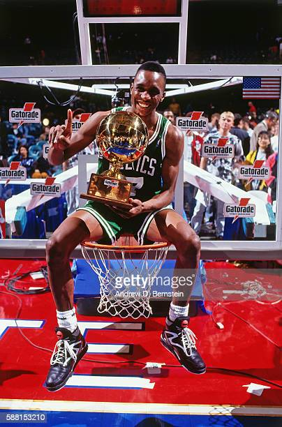 Dee Brown of the Boston Celtics celebrates after winning the 1991 Slam Dunk Contest at the Charlotte Coliseum in Charlotte North Carolina NOTE TO...