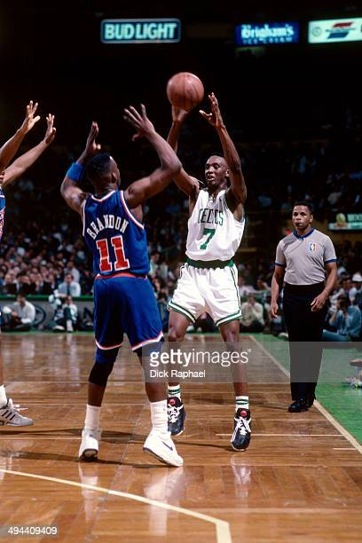 Dee Brown of the Boston Celtics passes the ball against Terrell Brandon of the Cleveland Cavaliers during a game played in 1992 at the Boston Garden...