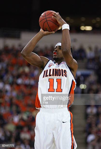 Dee Brown of the Illinois Fighting Illini attempts a shot against the Fairleigh Dickinson Knights in the first round game of the NCAA Division I...