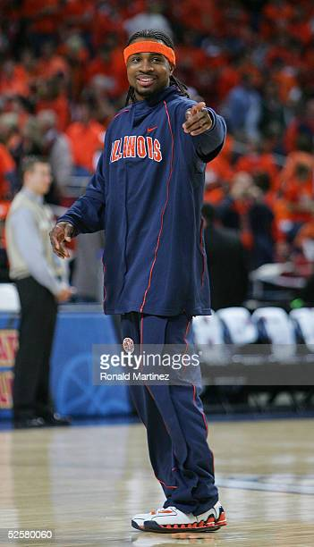 Dee Brown of the Illinois Fighting Illini gestures as he warmsup before the start of the NCAA Men's Final Four against the Louisville Cardinals at...