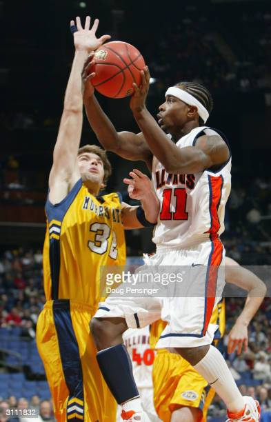 Dee Brown of the Illinois Fighting Illini gets off a shot over Chris Shumate of the the Murray State Racers during the first round game of the NCAA...