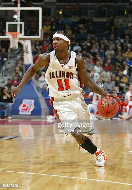Dee Brown of the Illinois Fighting Illini moves the ball during the first round game of the NCAA Division I Men's Basketball Tournament against the...