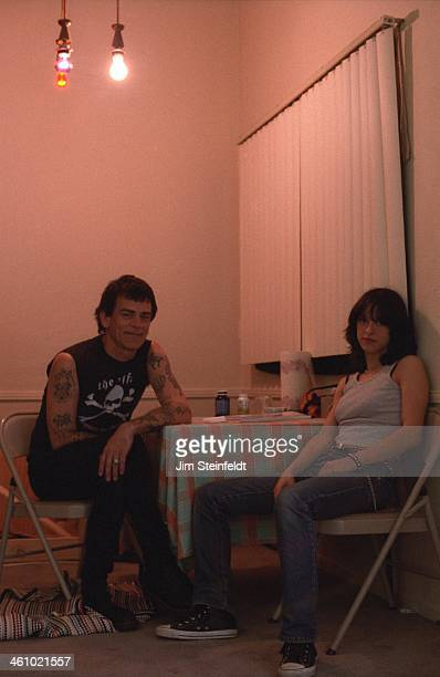 Dee Dee Ramone and his wife Barbara Ramone Zampini pose for a portrait during a photo session at their apartment in Los Angeles California on March...