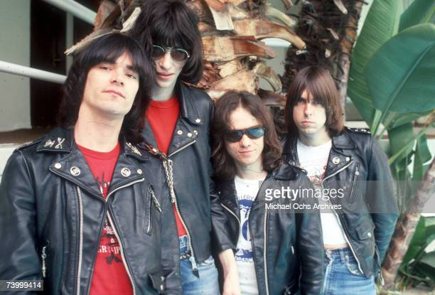 Dee Dee Ramone Joey Ramone Tommy Ramone and Johnny Ramone of the rock and roll band 'The Ramones' pose for a portrait holding letters that spell out...
