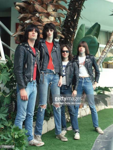 Dee Dee Ramone Joey Ramone Tommy Ramone and Johnny Ramone of the rock and roll band The Ramones pose for a portrait holding letters that spell out...