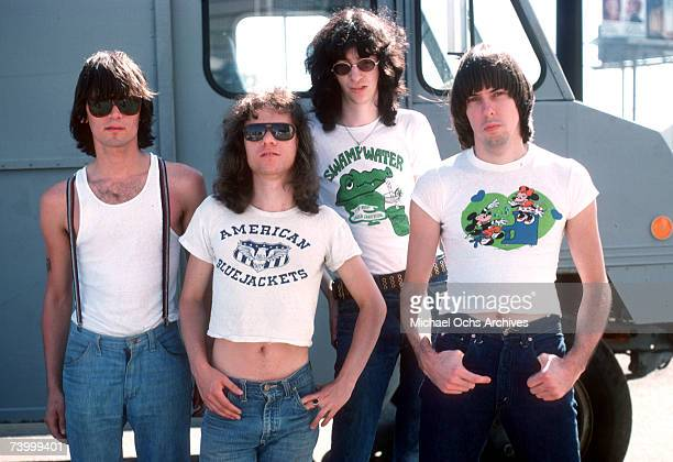"""Dee Dee Ramone, Tommy Ramone, Joey Ramone and Johnny Ramone of the rock and roll band """"The Ramones"""" pose for a portrait holding letters that spell..."""
