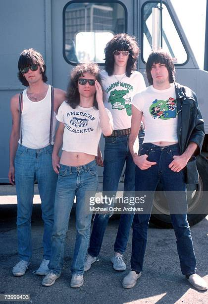 Dee Dee Ramone Tommy Ramone Joey Ramone and Johnny Ramone of the rock and roll band The Ramones pose for a portrait holding letters that spell out...