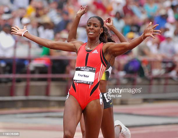 Dee Dee Trotter celebrates after winning the women's 400 meters in 4964 in the USA Track Field Championships at Carroll Stadium in Indianapolis Ind...