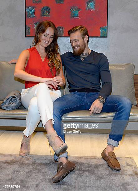 Dee Devlin and Host/VIP Conor McGregor attend the David Yurman with Conor McGregor Hosts an InStore Event on July 6 2015 in Las Vegas Nevada