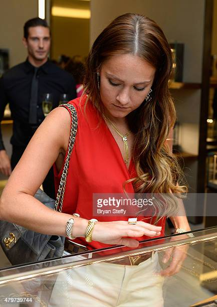 Dee Devlin tries on jewelry during the David Yurman with Conor McGregor Hosts an InStore Event on July 6 2015 in Las Vegas Nevada