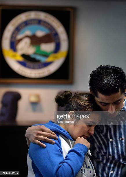 Dee Escobedo and Andy Fernandez embrace each other city hall in El Monte after news that their high school teacher Roberto Salcedo was killed in...