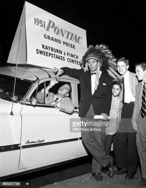 Dee Finch and Gene Rayburn radio deejays of the Rayburn and Finch morning drive time show in New York NY pose for a photo with a new 1951 Pontiac the...