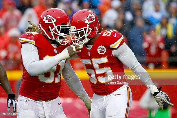 Dee Ford of the Kansas City Chiefs celebrates with teammate Tamba Hali at Arrowhead Stadium during the third quarter of the game against the San...