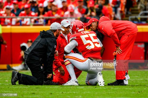 Dee Ford of the Kansas City Chiefs is attended to by medical staff following an injury during the fourth quarter of the game against the Jacksonville...