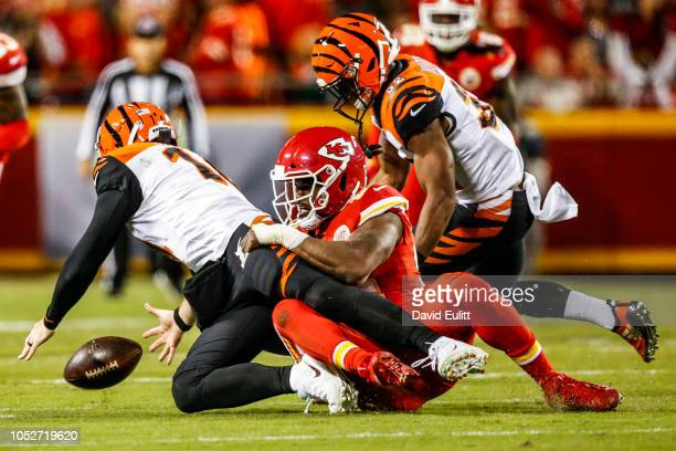 Dee Ford of the Kansas City Chiefs knocks the ball loose and sacks Andy Dalton of the Cincinnati Bengals during the first quarter of the game at...