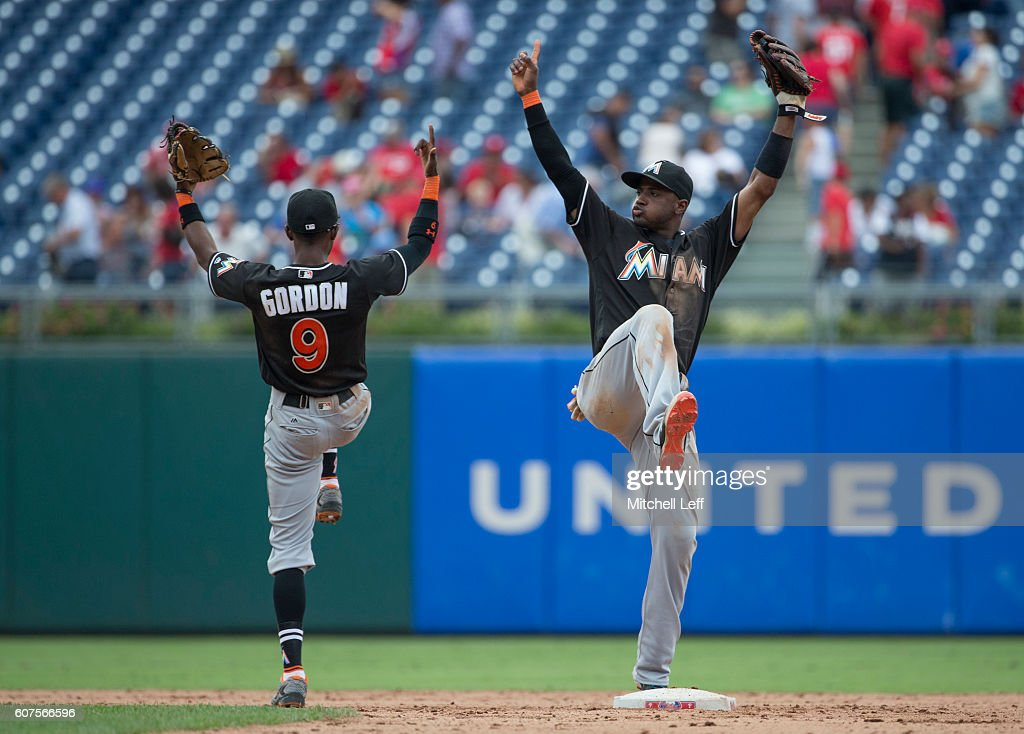 Dee Gordon #9 and Adeiny Hechavarria #3 of the Miami Marlins celebrate their win against the Philadelphia Phillies at Citizens Bank Park on September 18, 2016 in Philadelphia, Pennsylvania. The Marlins defeated the Phillies 5-4.