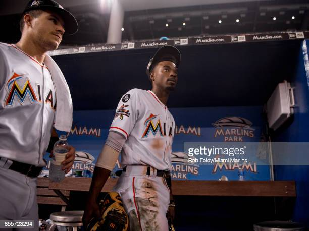 Dee Gordon and JT Realmuto of the Miami Marlins look on after the game against the Atlanta Braves at Marlins Park on September 29 2017 in Miami...