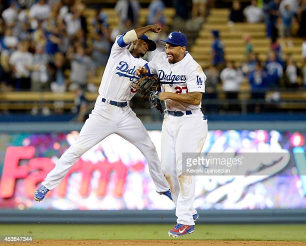 Dee Gordon and Matt Kemp of the Los Angeles Dodgers celebrate after defeating the San Diego Padres August 19 at Dodger Stadium in Los Angeles,...
