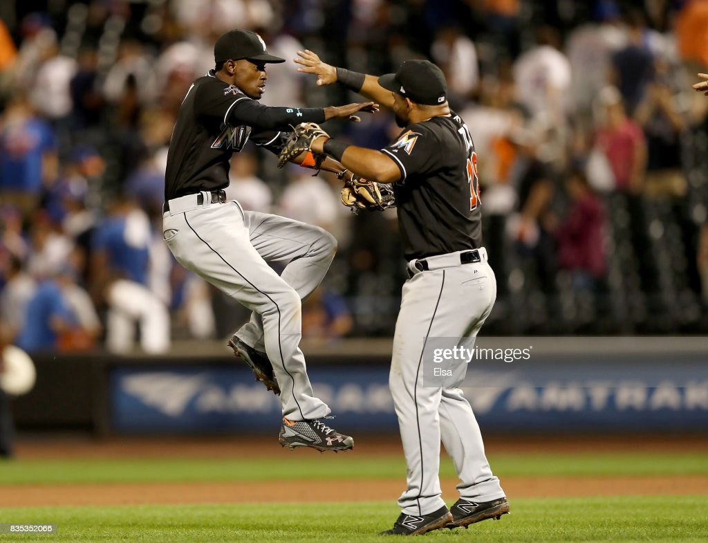 Dee Gordon #9 and Tomas Telis #18 of the Miami Marlins celebrate the 3-1 win over the New York Mets on August 18, 2017 at Citi Field in the Flushing neighborhood of the Queens borough of New York City.