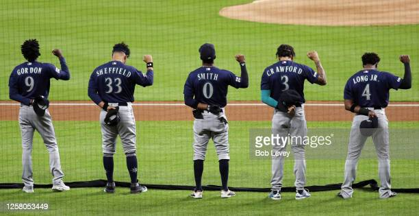 Dee Gordon Justus Sheffield Mallex Smith JP Crawford and Shed Long Jr #4 of the Seattle Mariners raise their fist during the national anthem before...